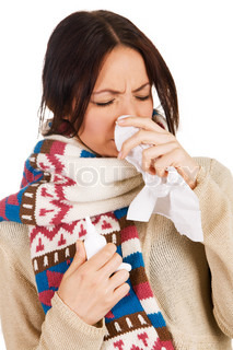 Cute young woman havign caught cold, with nose spray and handkerchief in her hands