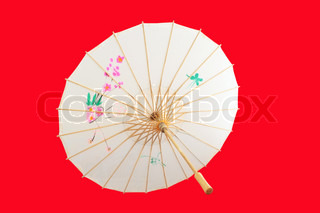Chinese umbrella isolated on red background