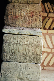 This photograph represent natural stones with ancient Sumerian writing