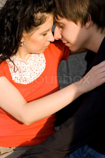 outdoor portrait of young loving couple kissing and hugging each other