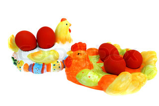 Easter red eggs on the hen and cock on white background