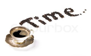 Studio photography of a coffee cup and written text made of coffee beans, isolated on white