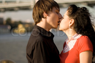 outdoor portrait of young loving couple kissing each other