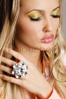 Fashionable young woman with vibrant makeup, face portrait