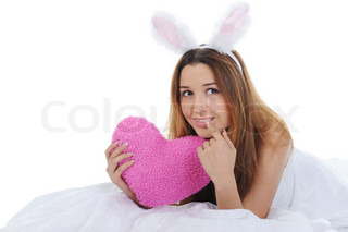Smiling woman with rabbit ears with Heart Isolated on white background