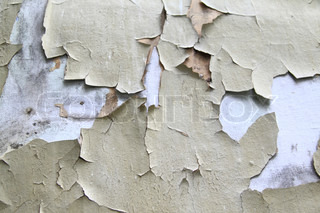 Old paint peeling from wall background or texture
