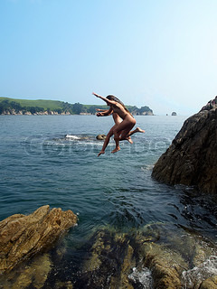 pair of diving beautiful young nude womans
