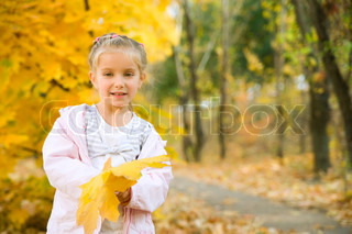 Autumn portrait of cute little caucasian girl