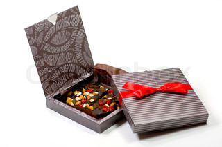 two gift boxes with chocolate on white background