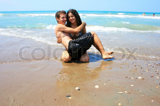 Teens having fun on the beach