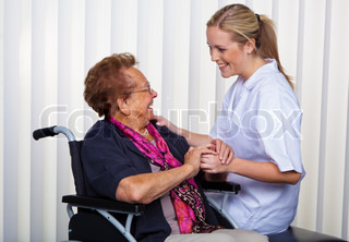 a nurse and an old woman in a wheelchair