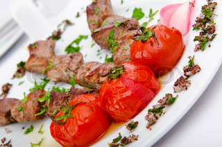 Meat kebab served in plate