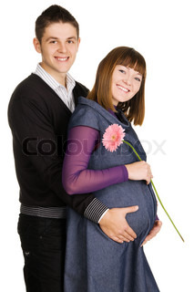 Beautiful pregnant woman with her husband studio portrait