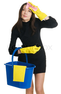 Young tired housewife in elegant dress holding a swab and bucket, white background