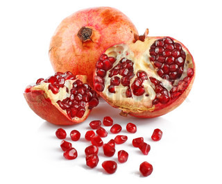 big sweet tasty ripe pomegranate with red seeds on white background isolated