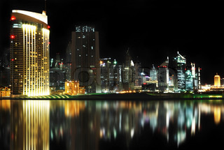 Dubai downtown at night reflected in water
