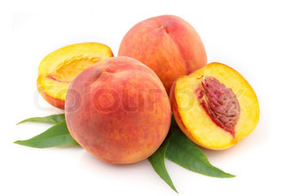 ripe peach fruits close up on the white