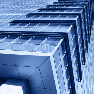 Corner of modern office building toned in blue color