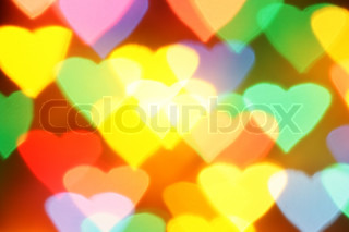 Colorful hearts bokeh, may be used as background