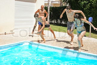 People jumping to swimming pool.