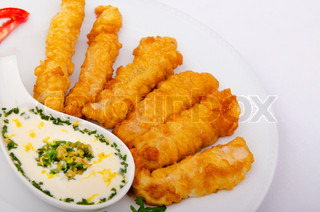 Battered chicken served with sauce