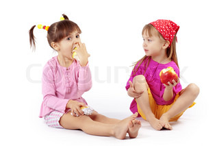 Portrait of cute kids eating apples over white