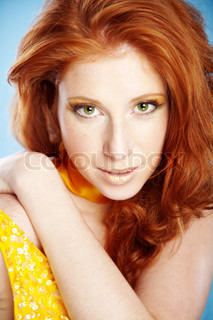 Beautiful redhead on blue background
