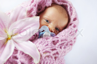 Newborn baby wrapped in knitted cover