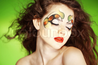 Fashion make-up with face art and hairstyle