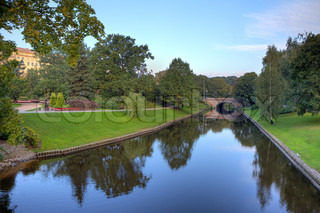 Beautiful city park with small canal in Riga, Latvia