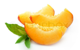 Juicy peach slices with mint closeup