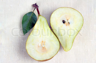 Two halves of pears on a white background