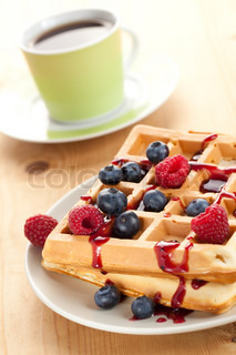 photo shot of tasty waffle with fruits