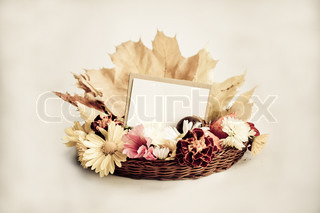 Stylized holiday background with empty greeting card for text and autumn flowers