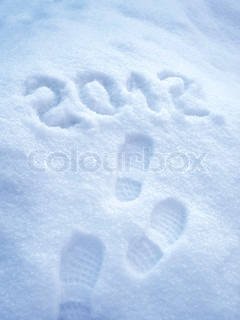 Foot step print in snow – New Year 2012 concept