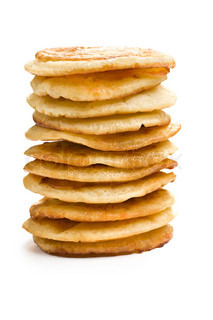pile of pancakes on white background
