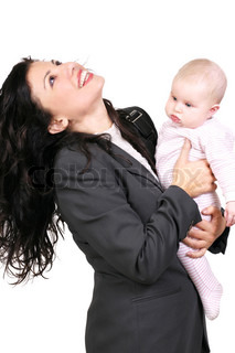 mother dressed in a suit holding her 5 month old baby girl
