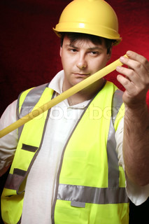 Builder with his trusty tape measure on a black/red background