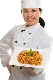 Smiling female chef holding Teller Pasta