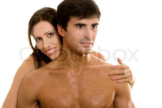 Young  happy couple embrace. White background.
