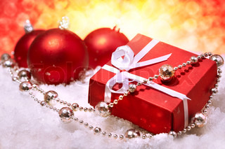 Christmas gift and balls on abstract background of