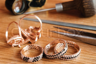 Jewelry and tools are on the table