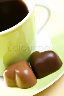 the chocolate hearts and coffee cup