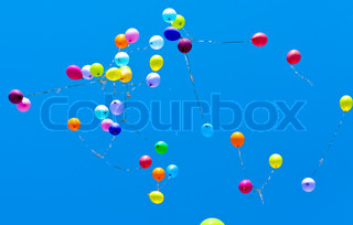 Many Beautiful Balloons In The Sky : ... girl holding bunch of colorful air balloons at the beach, stock photo