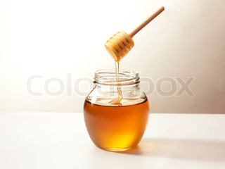 Warm honey in a traditional wooden stick