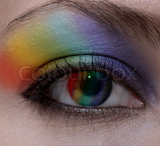 Beautiful female eye with make-up rainbow