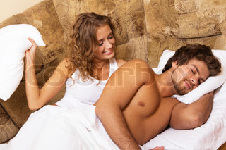Beautiful young couple waking up, home interior