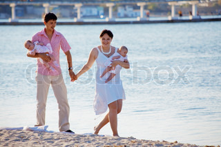 Happy family with two infant children