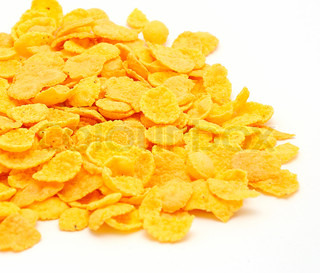 Gold corn flakes heaped on the white table
