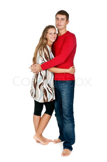 girl hugging a guy in a red dress in the studio on a white background